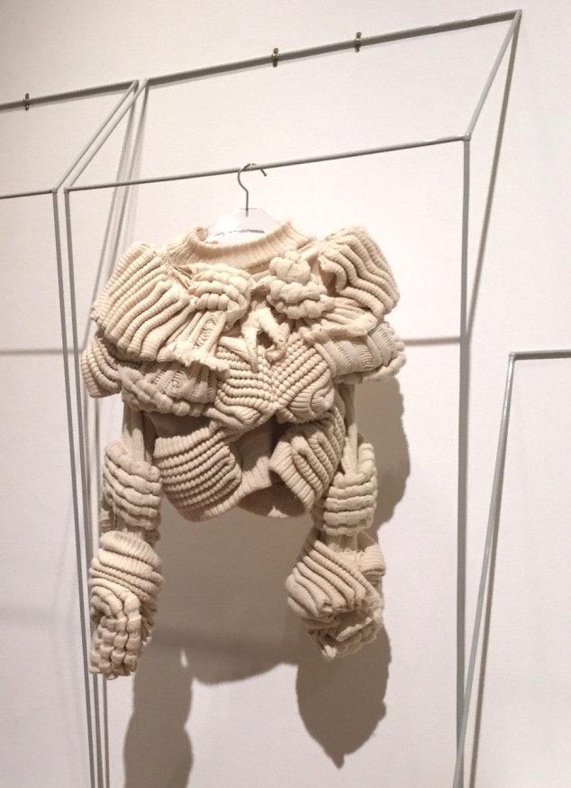 "Hand knit sweater in the ""Laboratory"" room."