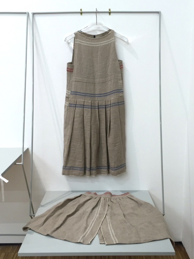 "Simple structured dress in the ""Uniform"" room."
