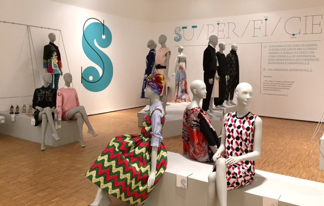 "Different mannequins wearing Italian designs in the ""Surface"" room."